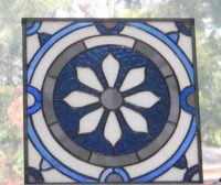 stained glass panel fashioned after a bathroom tile